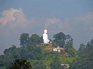 Buddha statue on a high hill overlooking Kandy, Sri Lanka