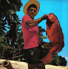 Seychellois fisherman with a fish